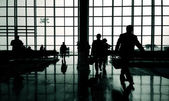 Business travelers at airport — Stock Photo