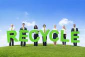 Business people Holding word Recycling — Stock Photo