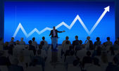 Group of business people and presentation — Stock Photo