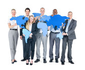 Business People holding maps — Stock Photo