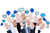 Business people's hands with speech bubbles — Stock Photo
