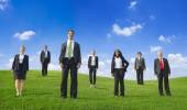 Group of green business people — Stock Photo