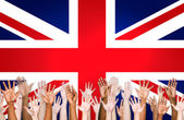 Multi-Ethnic Hands With British Flag — Stock Photo