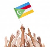 People Holding Flag Of Comoros — 图库照片
