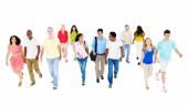 Group of multi-ethnic people walking — Stock Photo