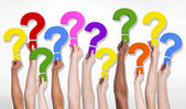 Human hands holding question marks — Stock Photo