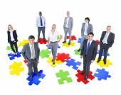 Business People on puzzle — Stock Photo