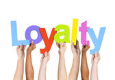 People Holding Word Loyalty — Stock Photo