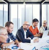 Business People Working In A Boardroom — Stock Photo