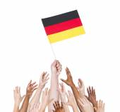 Hand holding Germany flag — Stock Photo