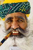 India man smoking pipe — Stock Photo