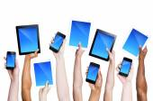 Hands holding smartphones and tablets — Stock Photo
