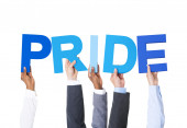 Business People Holding Pride — Stockfoto