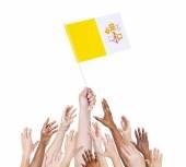 Human hand holding Vatican city flag — Stock Photo