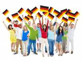 Diverse People Holding National Flag — Stock Photo