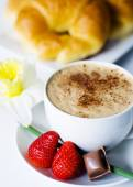 Cafe mocha, strawberries, chocolate, and croissant — Stock Photo