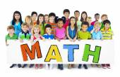 Diverse Cheerful Children Holding the Word Math — Stock Photo