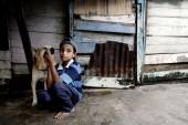 Indian boy with his dog — Stock Photo