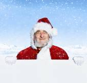 Santa claus holding blank sign — Stock Photo