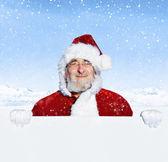 Santa claus holding blank sign — Stock Photo
