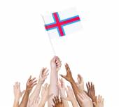People holding flag of Faroe Islands — Stock Photo