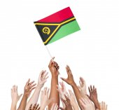 Human hand holding Vanuatu flag — Stock Photo