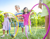 Children playing with Hula Hoops — Stock Photo