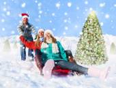 People sledding in snow — Stock Photo