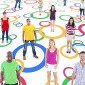 Group of Multi-Ethnic Socially Connected People on Colorful Circ — Stock Photo