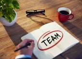 Businessman Writing Word 'Team' — Stock Photo