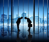 Two Businessmen Bowing To Each Other In An Office Building — Stock Photo