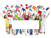 People holding flags and white placard — Stock Photo