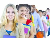 Multi-ethnic group of student standing in line — Stock Photo
