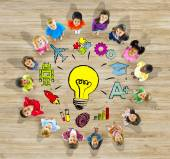 Group of Children in Circle with Light Bulb — Stock Photo