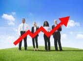 Business People Holding Developed Line Graph — Stock Photo
