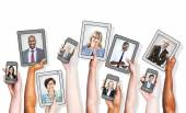 Business People on different devices — Stock Photo