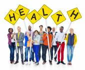 People Holding Sign That Reads Health — Stock Photo