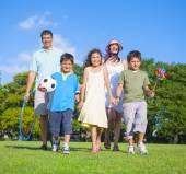 Family walk in park — Stock Photo