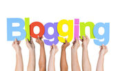 People Holding Word Blogging — Stock Photo