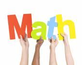 People Holding Word Math — Stock Photo