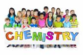 Diverse Cheerful Children Holding the Word Chemistry — Stock Photo