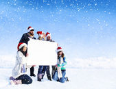 People holding blank placard on snow — Stockfoto