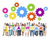 People Holding the word Teamwork — Stock Photo