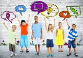 Smart kids with icons — Stock Photo