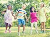 Children jumping in the park — Stock Photo