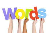 Arms Holding word Words — Stock Photo