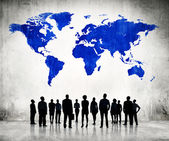 Business People And Blue Cartography Of World — Stock Photo