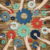 Hands Holding Gears Symbol — Stock Photo