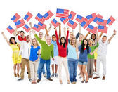 People Holding North American Flag — Stock Photo