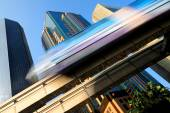 Skytrain speeding through business district — Stock Photo